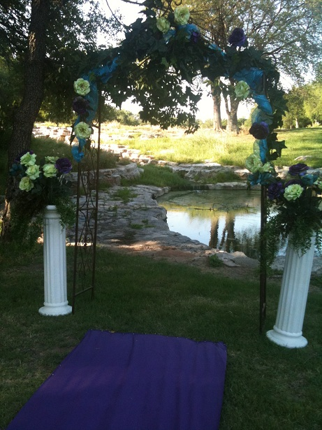 Decorated arch and arrangements by the Pink Orchid